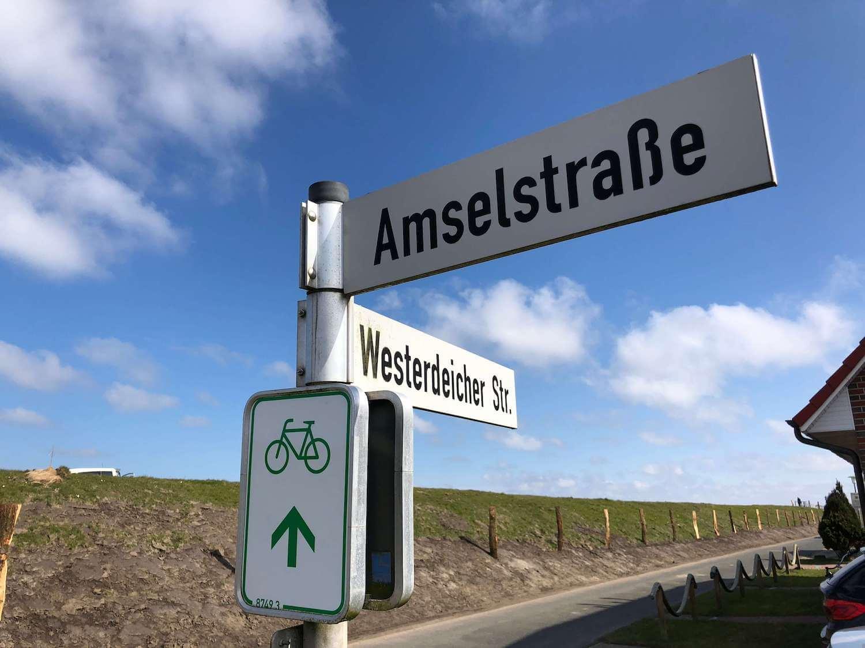 Straßenschild Amselstraße am Deich